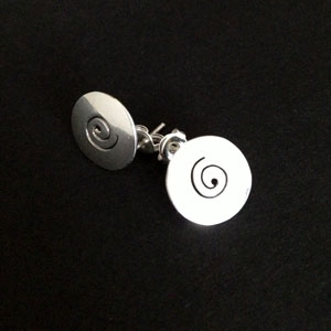 Circle silver earrings with swirl detail