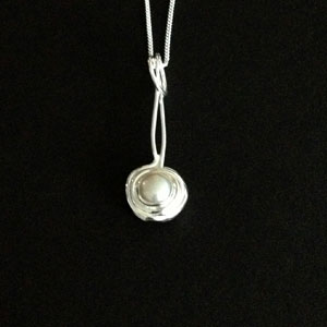 Nested silver pearl pendant