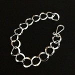 Oval dented silver bracelet