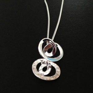 Twisted rings silver pendant