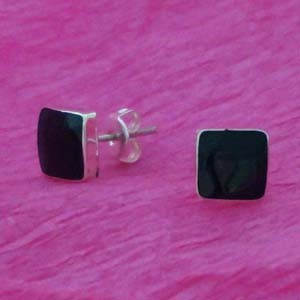 Squared silver earrings on resin