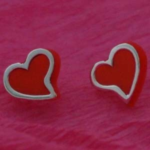 silver heart studs on acrylic