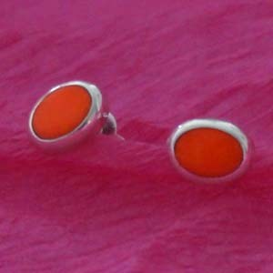 silver and orange stone studs