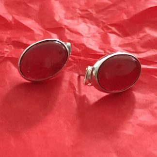 Silver earrings with red stone