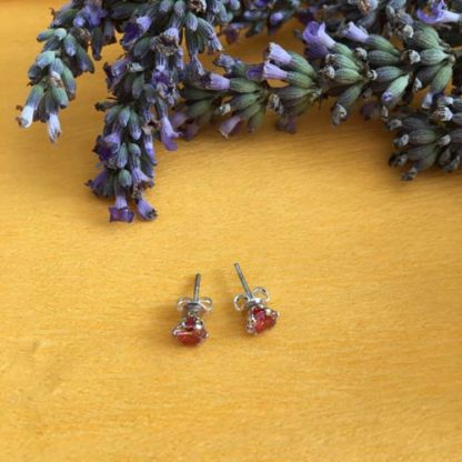 Silver studs with red crystal