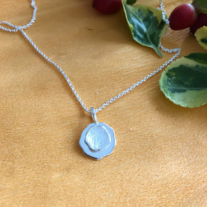 Button silver pendant
